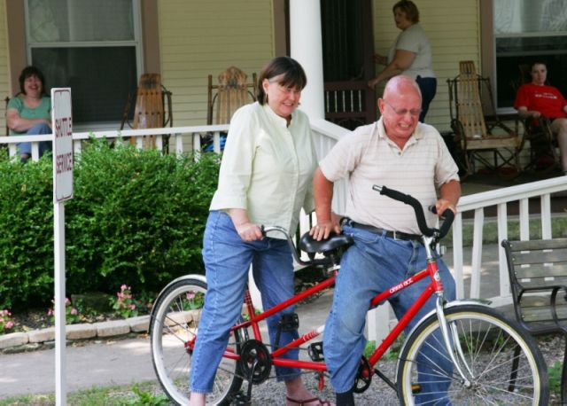 Darlene and John fail to ride a tandem bike